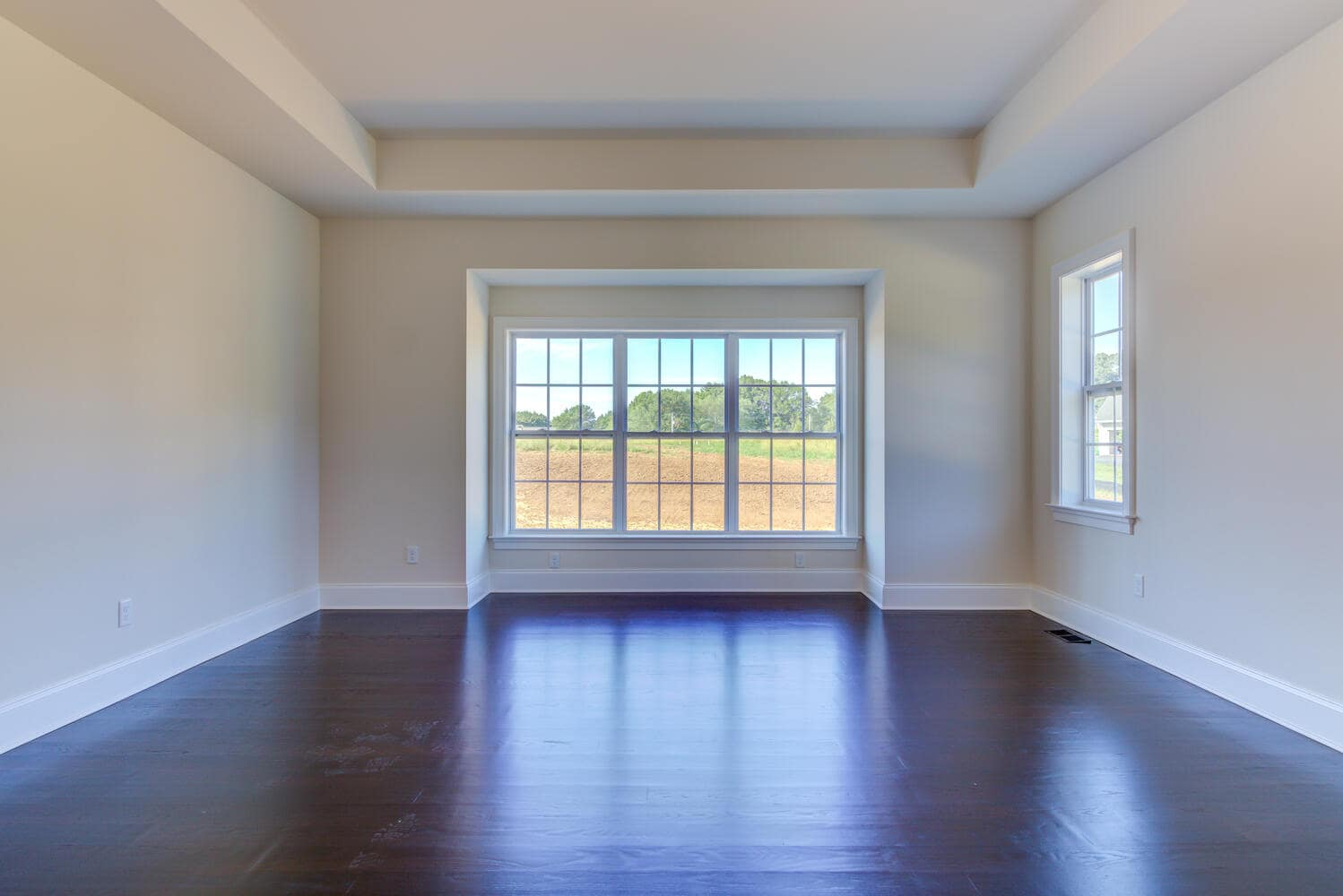 Empty bedroom in a new home from Bentley Homes.