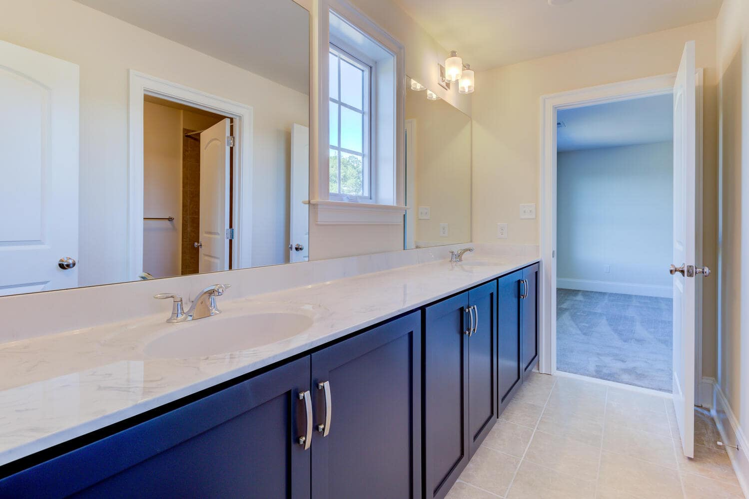 Double vanity bathroom in a new home from Bentley Homes.