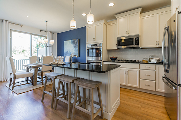 Bentley Homes kitchen with island and bar stools.